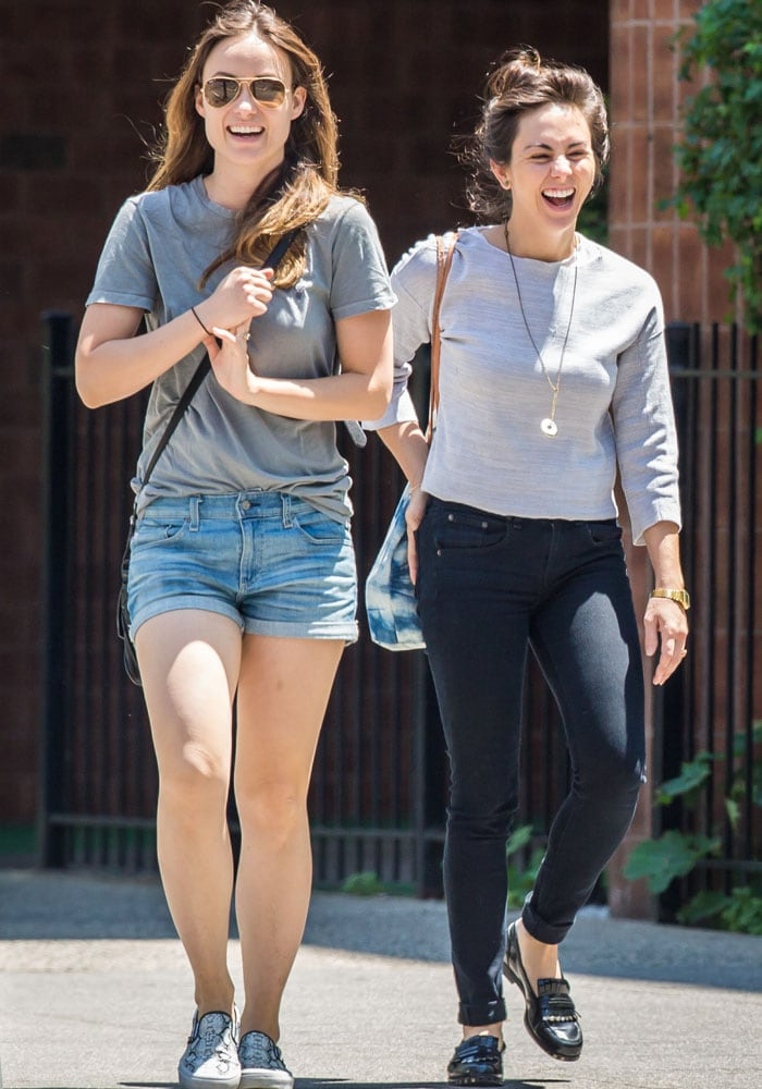 Olivia Wilde in good spirits while out with a friend on a sunny day in Brooklyn