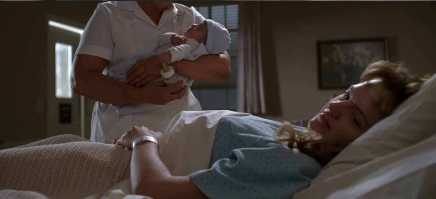Peggy Olson refuses to look at the baby and later gives the child up for adoption