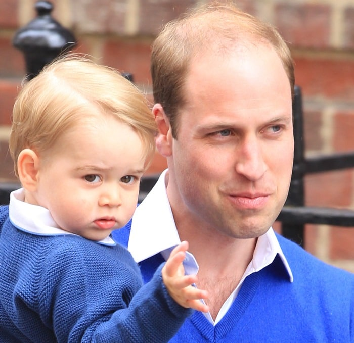 Prince William, Duke of Cambridge, carrying Prince George of Cambridge