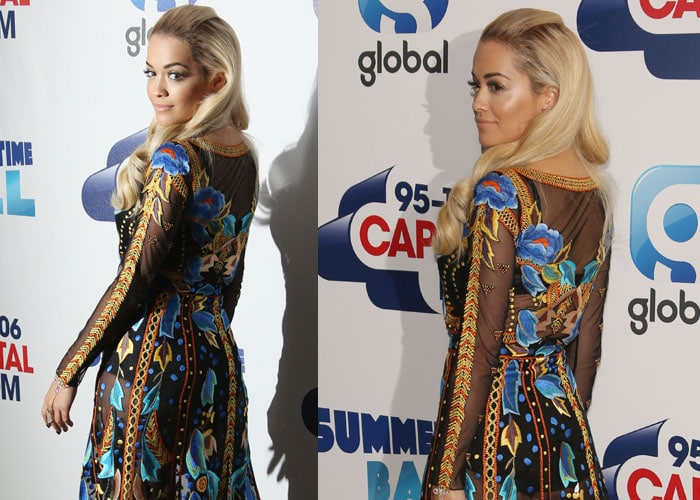 Rita Ora shows off the back of her lovely dress