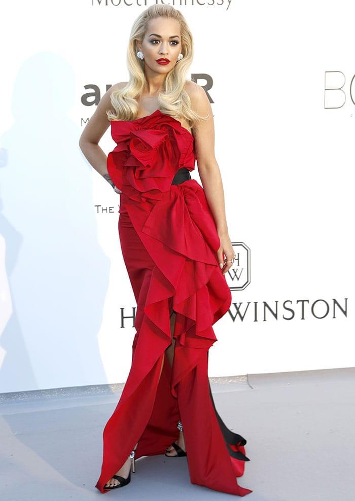 Rita Ora's red Marchesa dress featuring an asymmetric ruffled front design