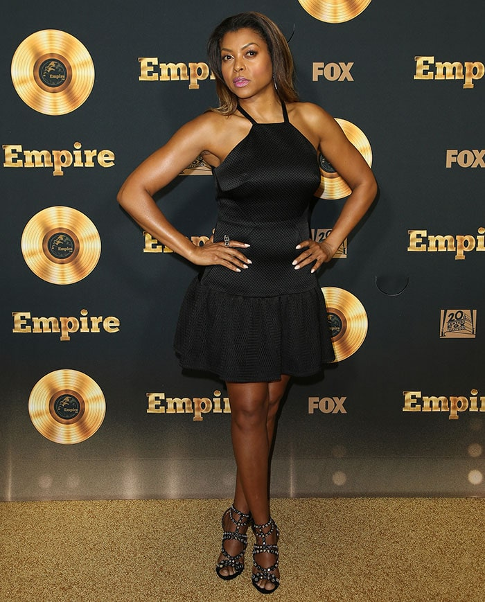 Taraji P. Henson wore a black halter mini dress, which highlighted her toned arms and legs