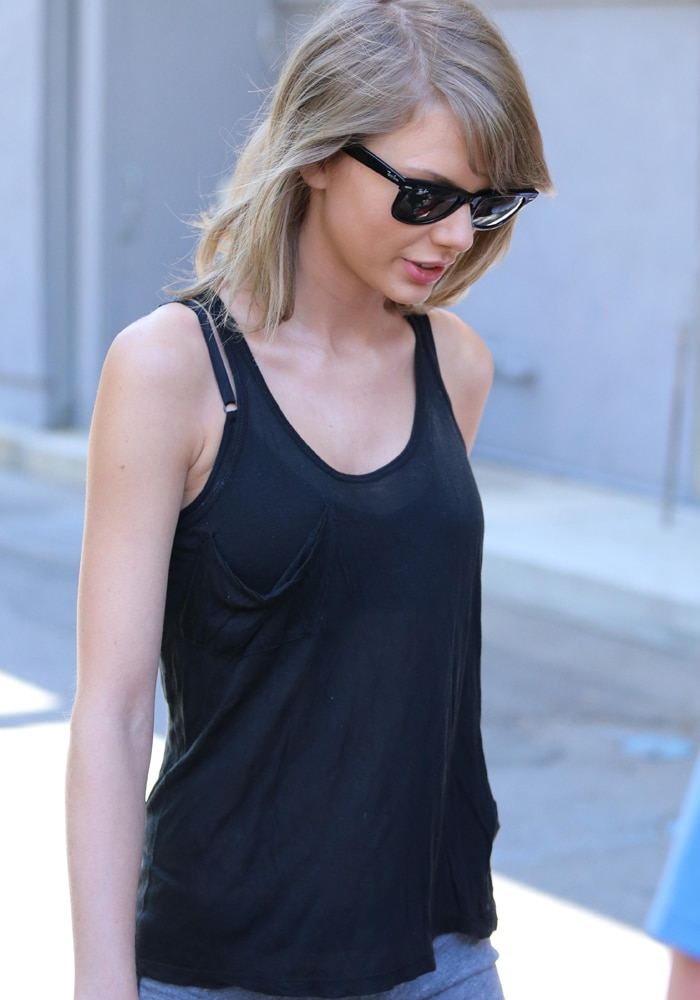 Taylor Swift wore a sheer tank top, running shorts, and a pair of wayfarers