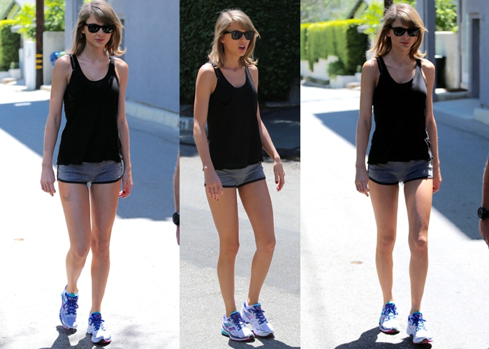 Taylor Swift Taylor wore a sheer tank top, running shorts, and a pair of wayfarers
