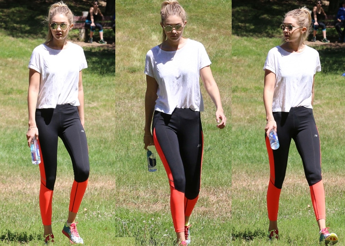 Gigi Hadid chose neon combination leggings from New Balance and tucked a plain white shirt into its waistband