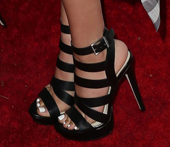 Victoria Justice showed off her feet in black Mystic shoes