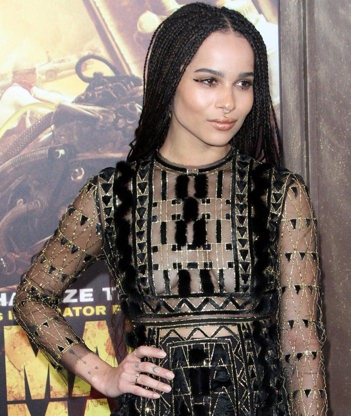 Zoë Isabella Kravitz in a black and gold sheer dress