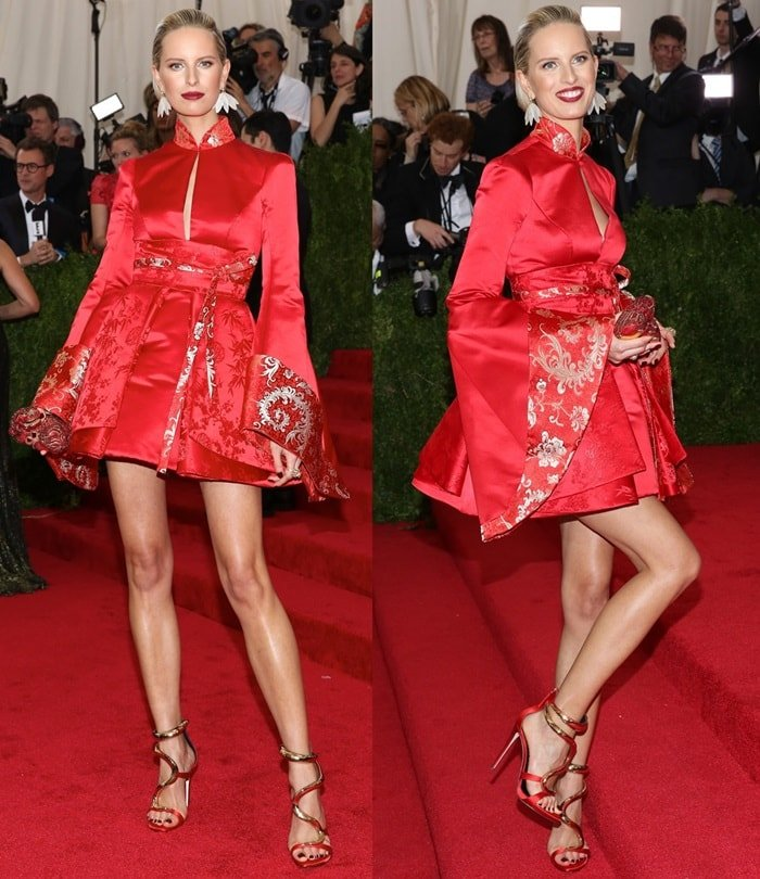 Karolina Kurkova flaunts her gorgeous legs in a red kimono-style mini dress designed by Tommy Hilfiger
