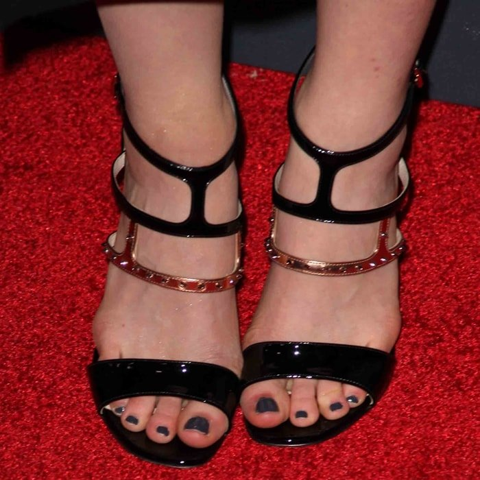 Leven Rambin's sexy feet in stud-embellished shoes