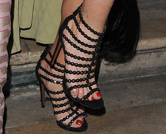 Lindsay Lohan paired her outfit with gorgeous mirrored laser-cut heels from Alaïa