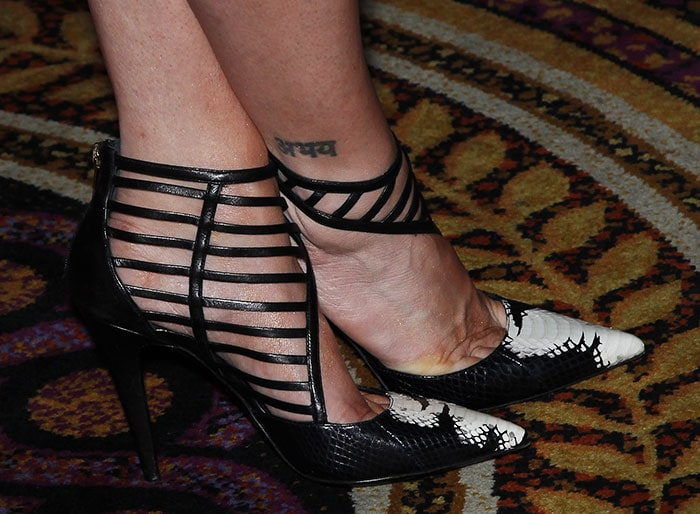 Brittany Snow's Sanskrit inscription tattoo on the outside of her right ankle