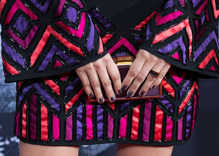 Camilla Belle's statement rings and a Jimmy Choo clutch