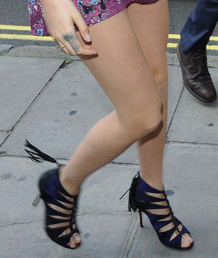 Cara-Delevingne-shows-legs-in-cage-sandals