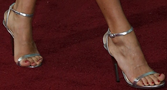 Carrie Underwood shows off her feet insilver ankle-strap evening sandals from Jimmy Choo