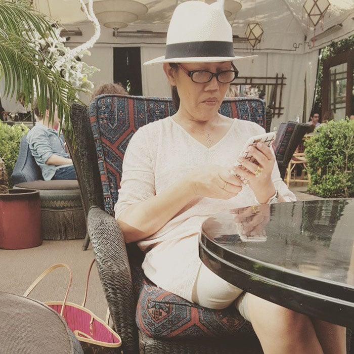 Vilailuck Teigen updating her Instagram