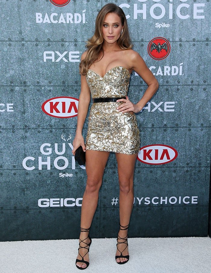 Hannah Davis flashed her legs in a shimmering gold sequin mini dress