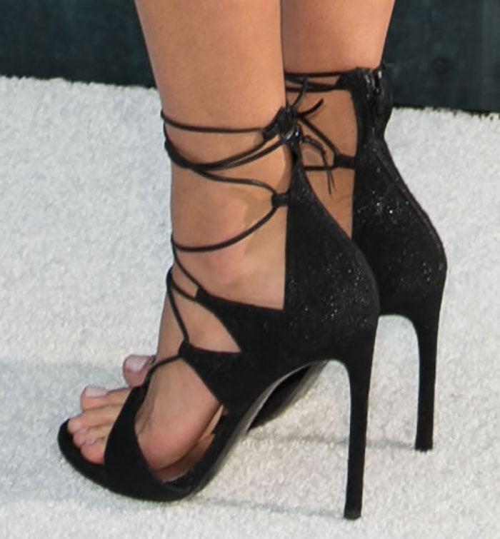 Hannah Davis rocked strappy black sandals by Stuart Weitzman