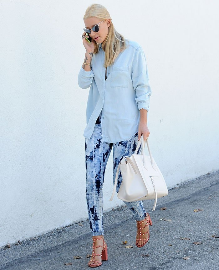 Iggy Azalea rocked a light blue loose-fitting button-down shirt and patterned skinny jeans