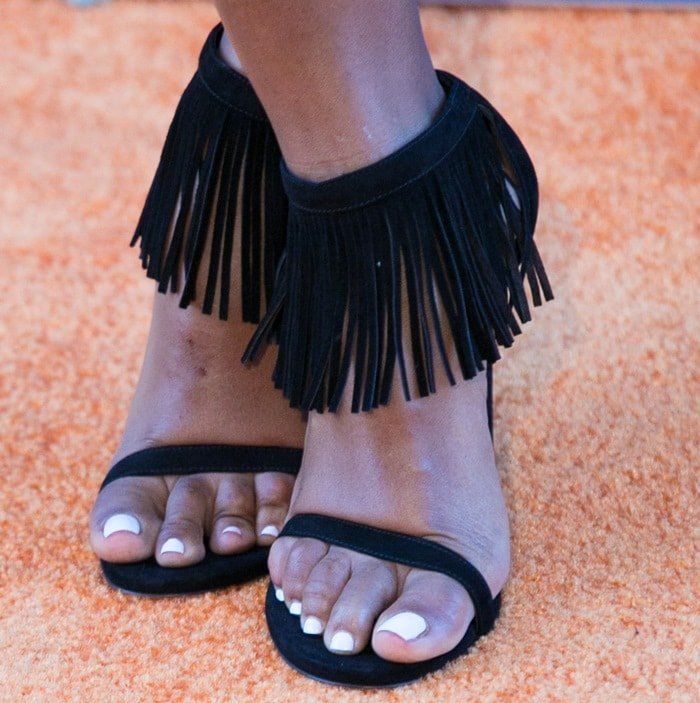 Janelle Monáe Robinson's sexy toes in sandals with fine fringe accents