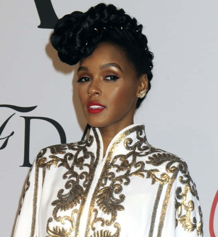 Janelle Monáe Robinson wore a white and gold embroidered cape dress from Tadashi Shoji
