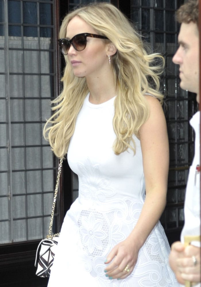 Jennifer Lawrence looking glum while leaving her hotel