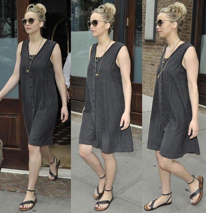 Jennifer Lawrence parades her legs in a loose-fitting polka-dot mini dress