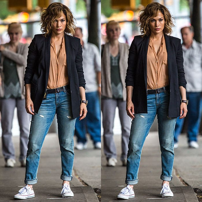 "Jennifer Lopez striking fierce poses in her costume as a single mom who goes undercover for the FBI in the new NBC TV series ""Shades of Blue"""