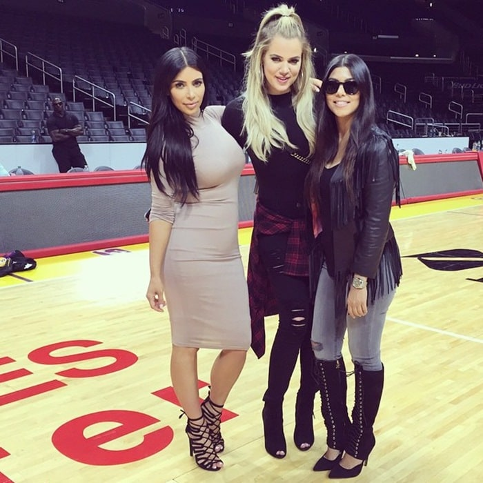 """Shared by Khloé Kardashian with the caption """"Sandwiched by two MILFs!!! I'm not complaining 😝 Kourt I see you rocking your @kardashiankollection boots girl!"""""""