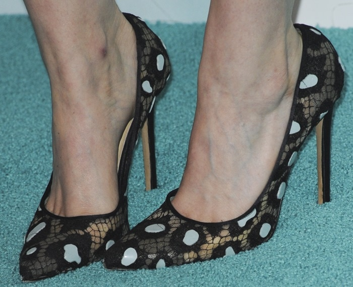 Kate Mara's camouflage black lace single sole pumps