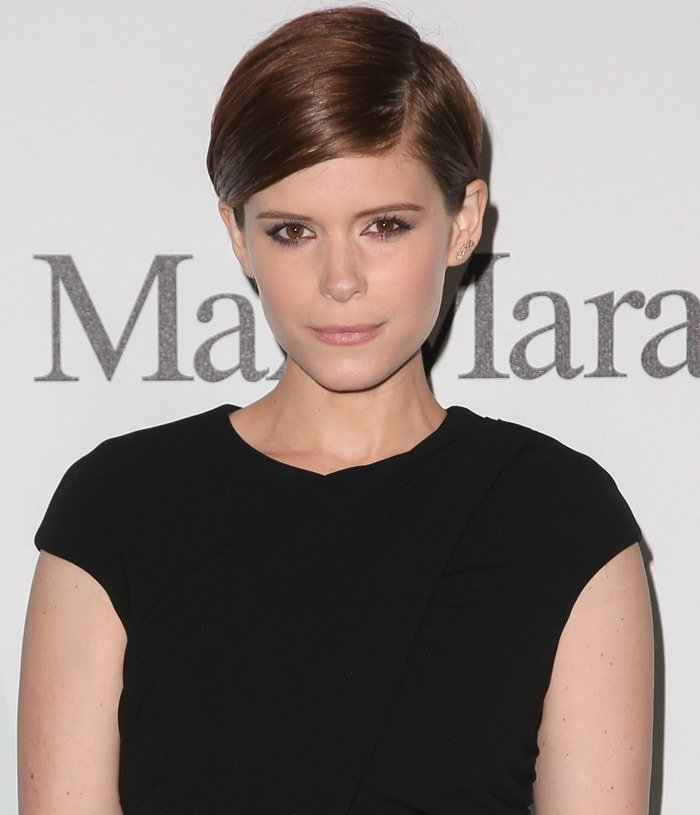 Actress Kate Mara shows off her coppery pixie cut and her black Max Mara dress