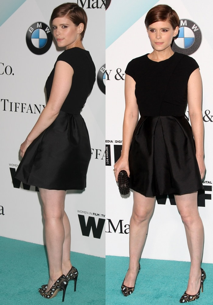 "Kate Mara flaunts her long legs in a Max Mara mini dress paired with the ""Daphne Bis"" pumps from Bionda Castana"
