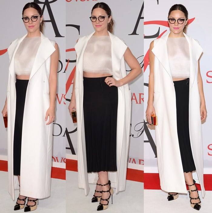 Katharine McPhee in a black Paule Ka skirt styled with an awful sleeveless Amanda Wakeley coat and a white crop top