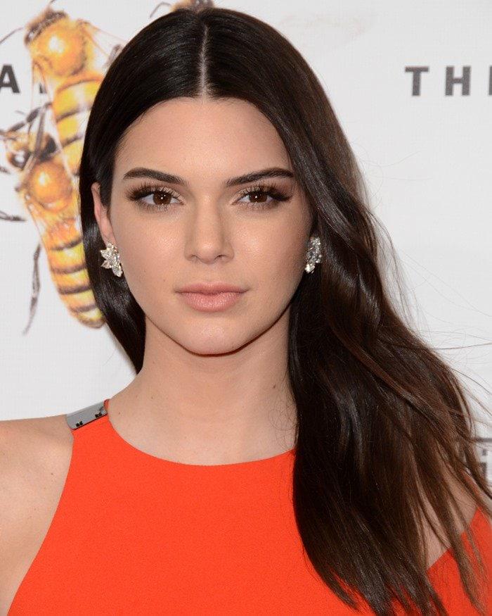 Kendall Jenner shows off herjewel-encrusted floral earrings