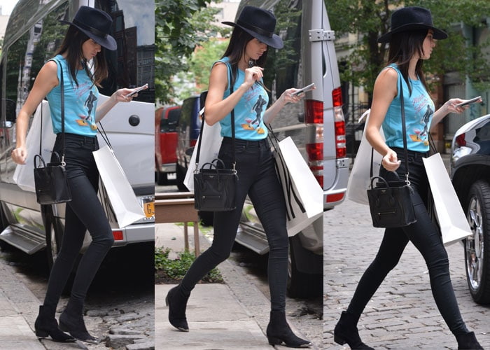 Kendall Jenner tucked her shirt into a pair of high waist skinny jeans