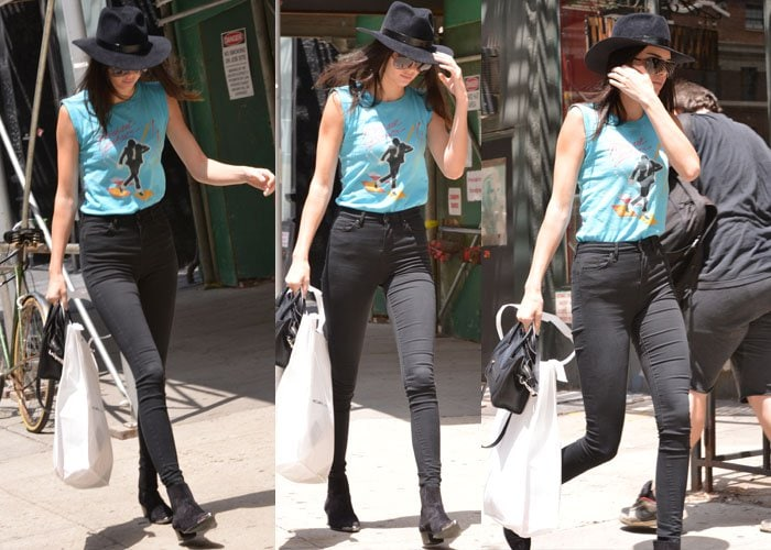 Kendall Jenner completed her look with Saint Laurent Duckies suede ankle boots