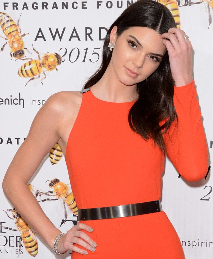Kendall Jenner in a thigh-high split red dress from Halston Heritage