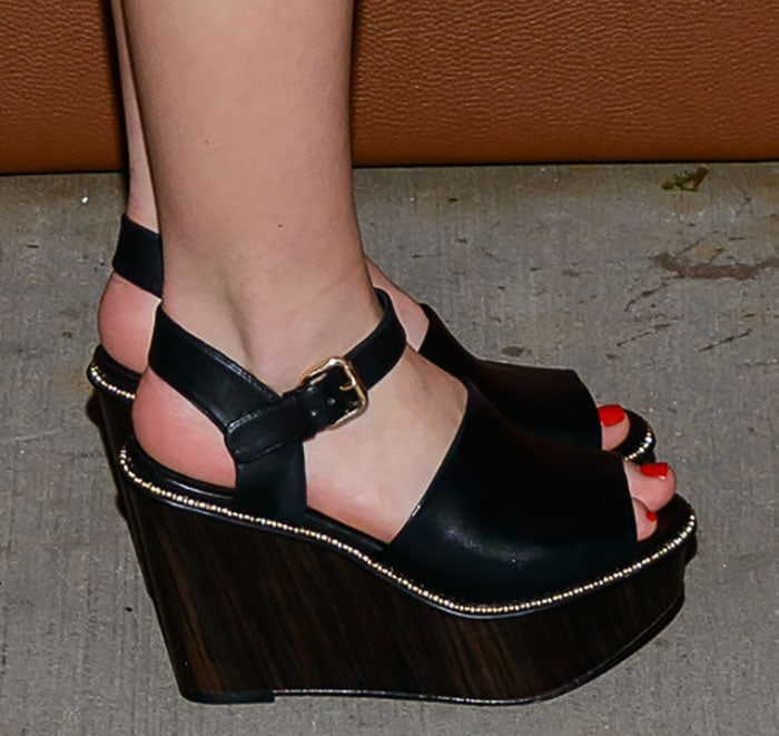 Kiernan Shipka's pedicured toes in Coach wedge sandals