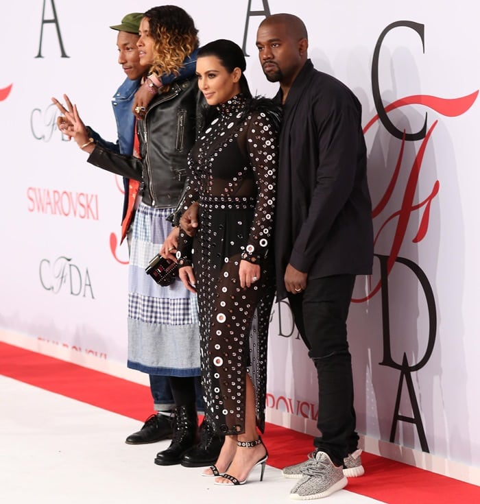 Kim Kardashian in a sheer dress with Kanye West, Pharrell Williams, and Helen Lasichanh at the 2015 CFDA Fashion Awards held at Alice Tully Hall at Lincoln Center in New York City on June 1, 2015