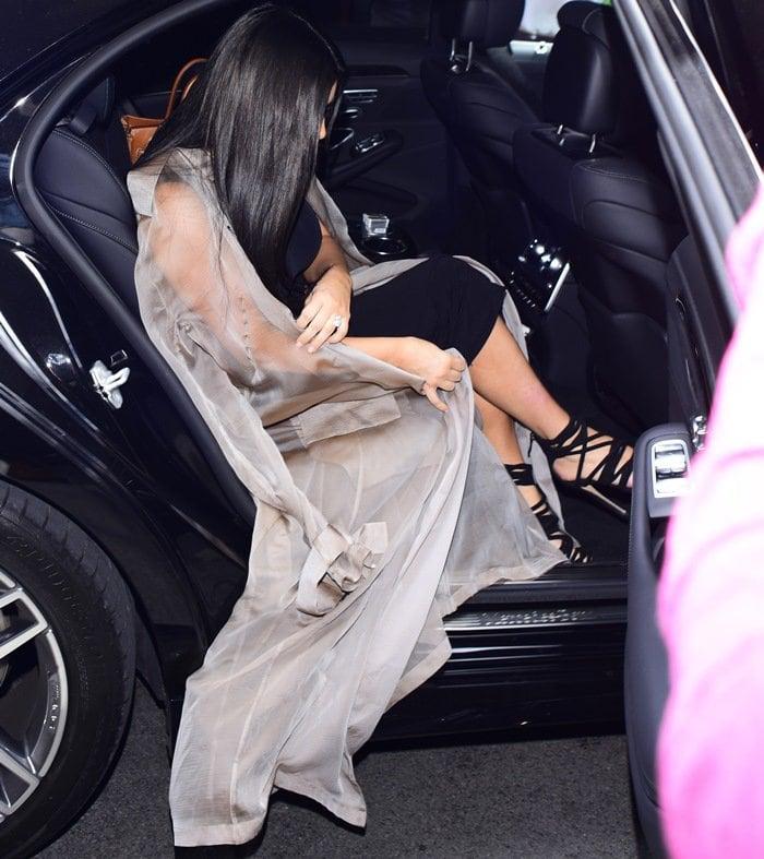 Kim Kardashian leaves her London hotel wearing a sheer dress that reveals her breasts