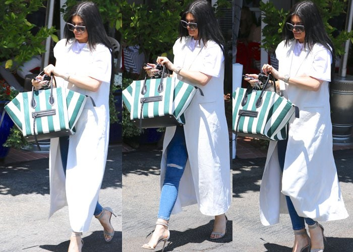 Kylie Jenner wore a plain tee with distressed jeans
