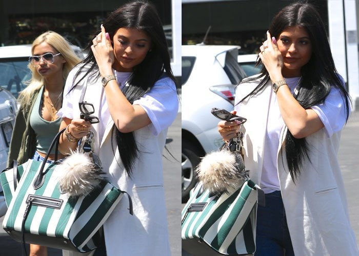 Kylie Jenner accessorized with some fun little trinkets