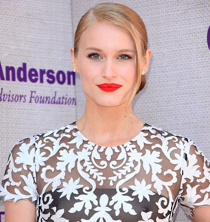 Leven Rambin styled her blonde hair into a low-rolled side-part updo
