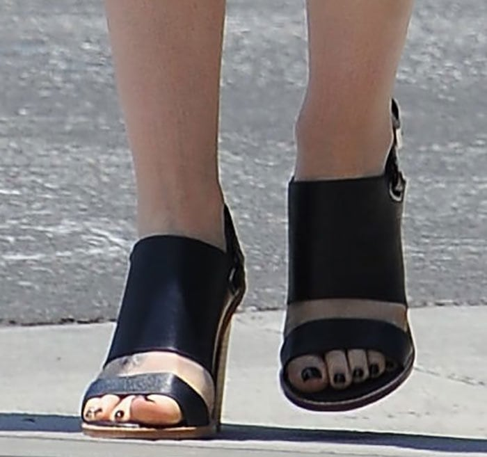 Lily Collins shows off her toes in shoes from the Australian footwear label
