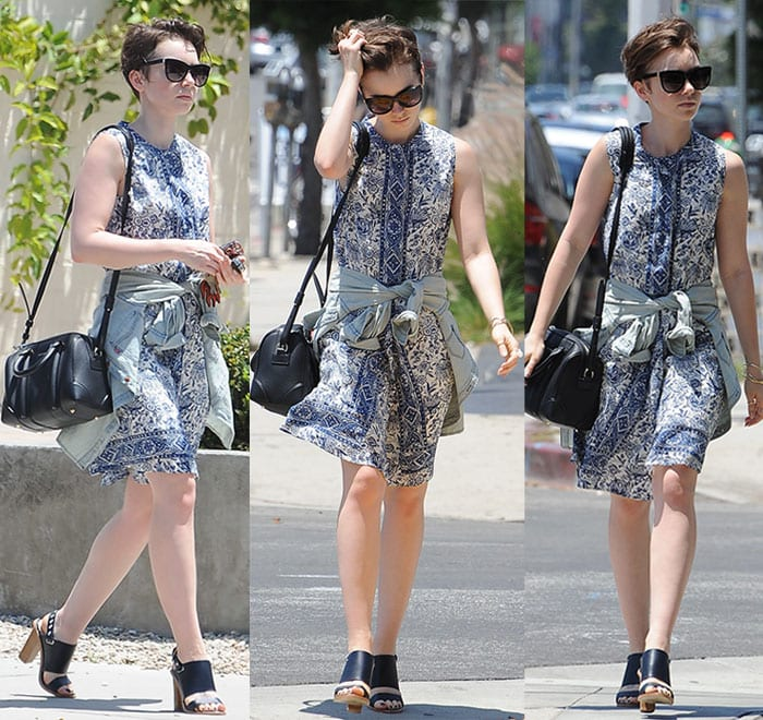Lily Collins flaunted her legs in a sleeveless floral-print dress