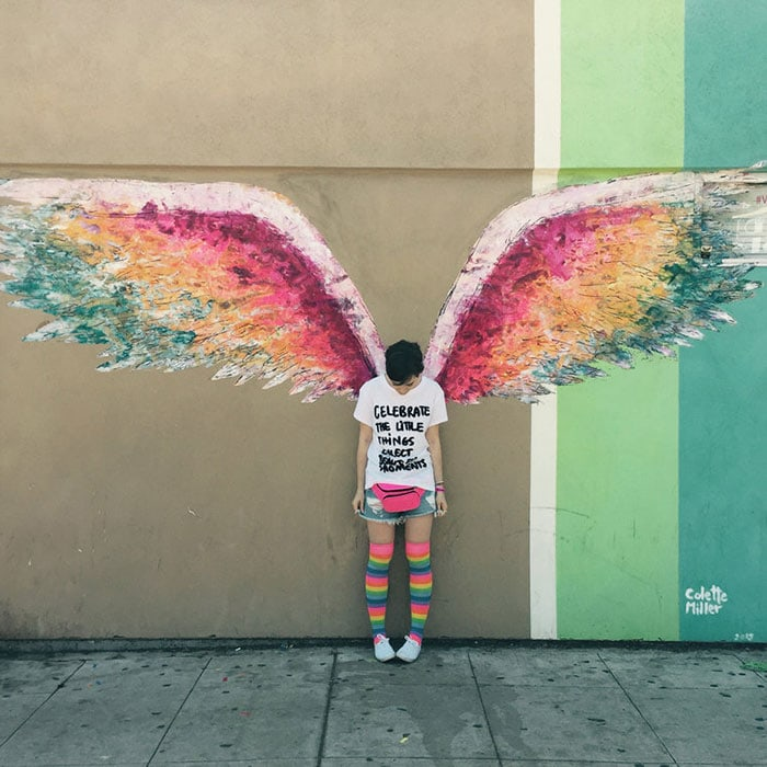 Lily Collins in front of the Angel Wings mural in Los Angeles