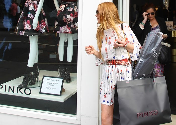 Lindsay Lohan shopped at Pinko, a contemporary, trend-focused Italian women's fashion brand