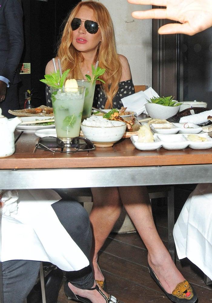 Lindsay Lohan enjoyed a meal at London's award-winning Japanese restaurant ROKA Mayfair