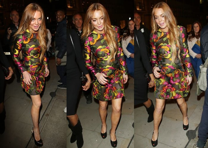 Lindsay Lohan paraded her legs in black peep-toe pumps