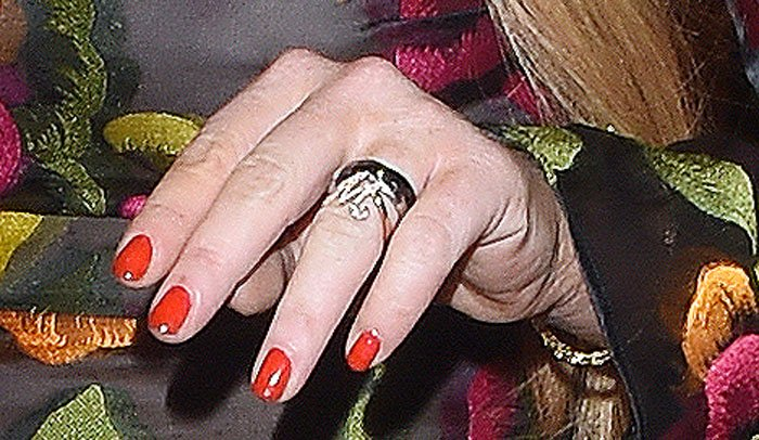 Lindsay Lohan wears a ring with the letter M on it