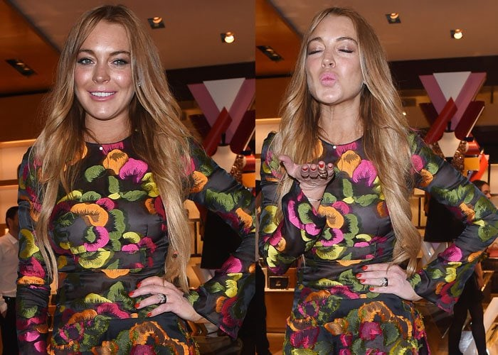 Lindsay Lohan smiles and blows a kiss to the cameras